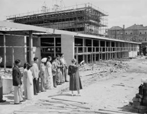 Students out front of a half constructed building.